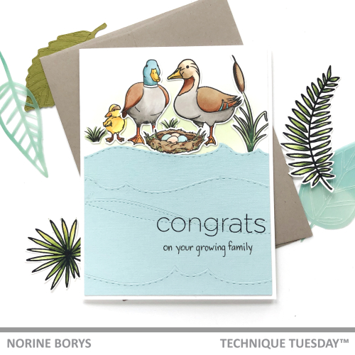 This Handmade First fathers day card, which can also be used as a father to be fathers day card shows a small family of ducks. Two adult ducks stand in the foreground around a full nest of eggs. One small duckling stands to the side. The words on the card read Congrats on your growing family