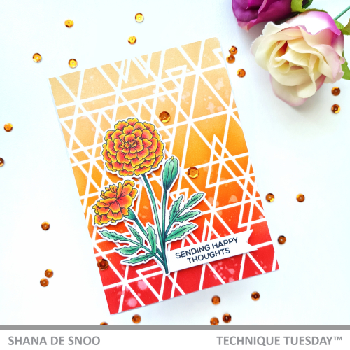 This Marigold flower diy card features the sentiment Sending Happy Thoughts. The background of this handmade marigold card design includes an array of white triangular shapes contrasted with the red and orange ink surrounding them. The stamped and die cut marigold flower is placed towards the bottom left of the card next to the sentiment banner. Three orange sequins decorate the handmade marigold card, and a handful of additional sequins are on the table surrounding it.