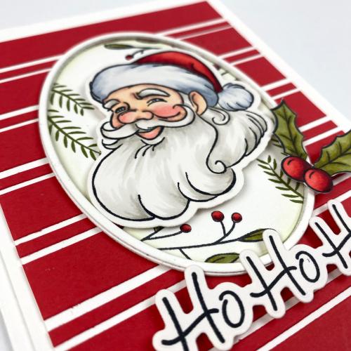 Image shows a handmade Santa card from up close. The sentiments on the card read Ho Ho Ho