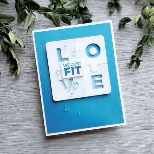 This diy father's day card for husband is decorated with the love puzzle crafting dies which display the word love letter by letter on four different pieces of a puzzle. Additionally this homemade fathers day card from wife features the sentiment We just fit.